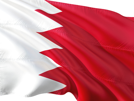 Flag of Bahrain waving in the wind, isolated white background. Stock Photo