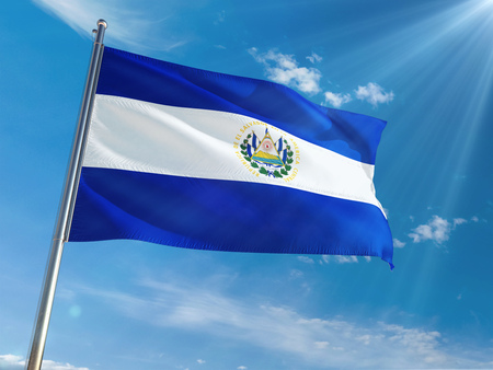 El Salvador National Flag Waving on pole against sunny blue sky background. High Definition