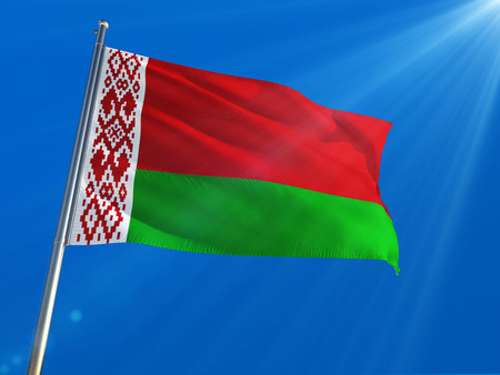 Belarus National Flag Waving on pole against deep blue sky background. High Definition