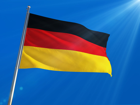 Germany National Flag Waving on pole against deep blue sky background. High Definition
