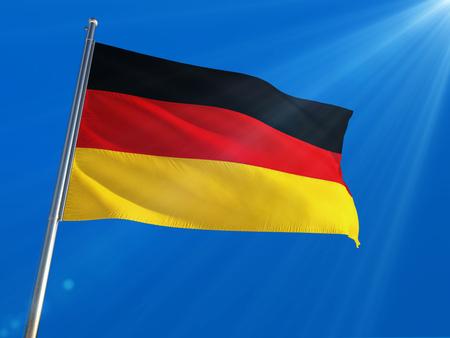 Germany National Flag Waving on pole against deep blue sky background. High Definition