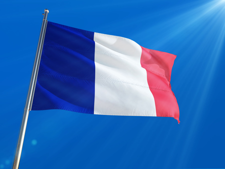 France National Flag Waving on pole against deep blue sky background. High Definition