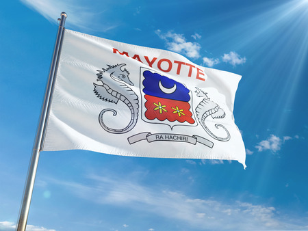 Mayotte National Flag Waving on pole against sunny blue sky background. High Definition Imagens