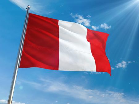 Peru National Flag Waving on pole against sunny blue sky background. High Definition