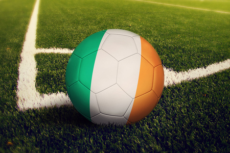 Ireland ball on corner kick position, soccer field background. National football theme on green grass. Banque d'images