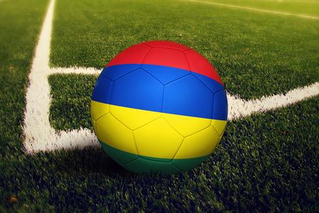 Mauritius ball on corner kick position, soccer field background. National football theme on green grass.