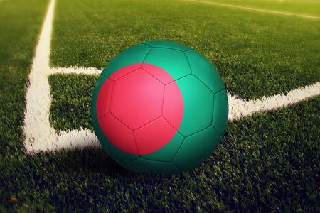Bangladesh ball on corner kick position, soccer field background. National football theme on green grass.