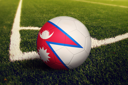 Nepal ball on corner kick position, soccer field background. National football theme on green grass.