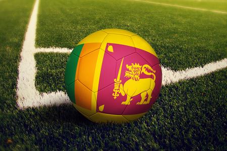 Sri Lanka ball on corner kick position, soccer field background. National football theme on green grass.