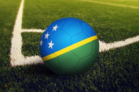 Solomon Islands ball on corner kick position, soccer field background. National football theme on green grass.