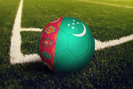 Turkmenistan ball on corner kick position, soccer field background. National football theme on green grass.