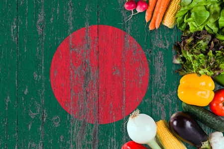 Fresh vegetables from Bangladesh on table. Cooking concept on wooden flag background.