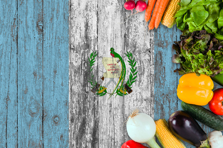 Fresh vegetables from Guatemala on table. Cooking concept on wooden flag background.
