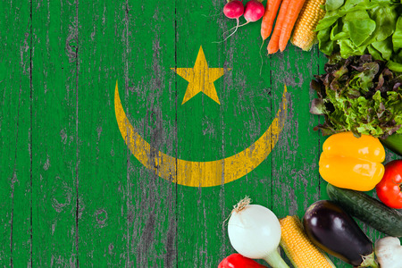 Fresh vegetables from Mauritania on table. Cooking concept on wooden flag background. Фото со стока