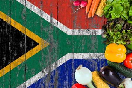 Fresh vegetables from South Africa on table. Cooking concept on wooden flag background.