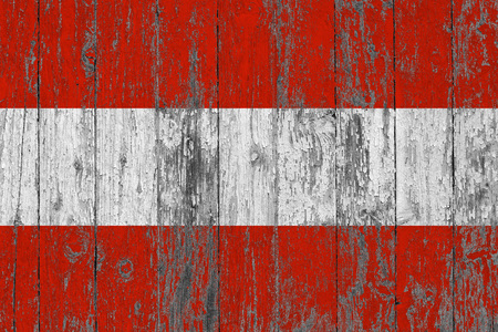 Flag of Austria painted on worn out wooden texture background. Stock Photo
