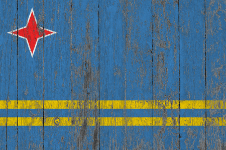 Flag of Aruba painted on worn out wooden texture background.