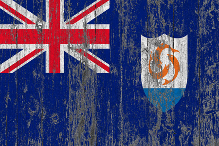 Flag of Anguilla painted on worn out wooden texture background.