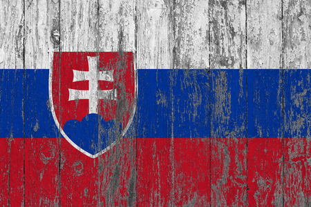 Flag of Slovakia painted on worn out wooden texture background.