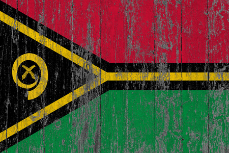 Flag of Vanuatu painted on worn out wooden texture background. Фото со стока