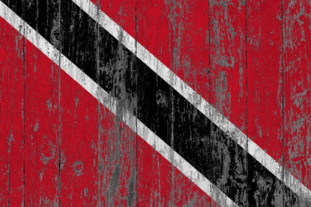 Flag of Trinidad And Tobago painted on worn out wooden texture background. Stock Photo