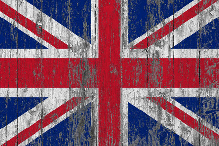 Flag of United Kingdom painted on worn out wooden texture background. Фото со стока