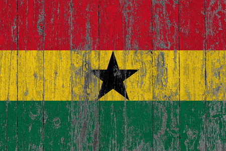 Flag of Ghana painted on worn out wooden texture background. Stock Photo