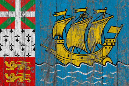 Flag of Saint Pierre And Miquelon painted on worn out wooden texture background.