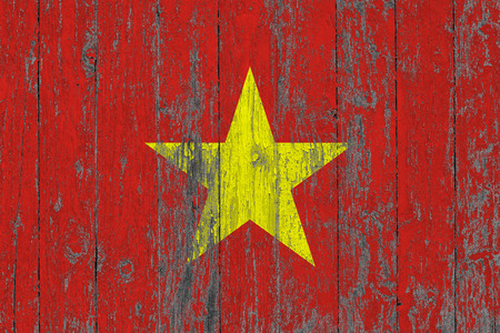 Flag of Vietnam painted on worn out wooden texture background. Stock Photo