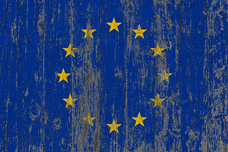 Flag of European Union painted on worn out wooden texture background.