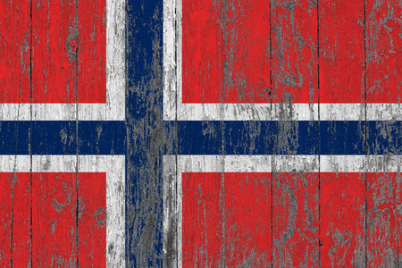 Flag of Norway painted on worn out wooden texture background.