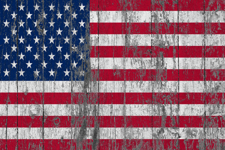 Flag of United States of America painted on worn out wooden texture background.