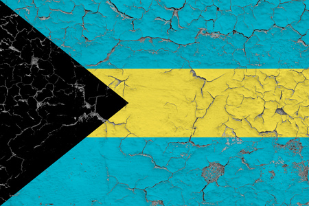 Flag of Bahamas painted on cracked dirty wall. National pattern on vintage style surface.