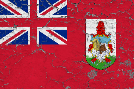 Flag of Bermuda painted on cracked dirty wall. National pattern on vintage style surface. Imagens