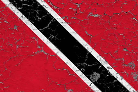 Flag of Trinidad And Tobago painted on cracked dirty wall. National pattern on vintage style surface.