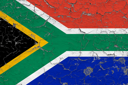 Flag of South Africa painted on cracked dirty wall. National pattern on vintage style surface.