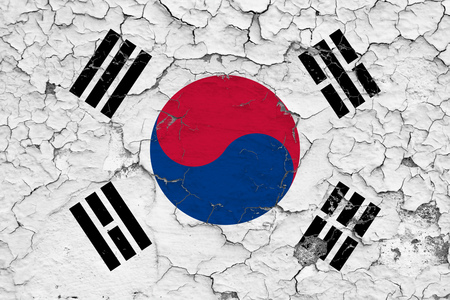 Flag of South Korea painted on cracked dirty wall. National pattern on vintage style surface.