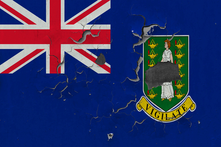 Close up grungy, damaged and weathered British Virgin Islands flag on wall peeling off paint to see inside surface. Stockfoto
