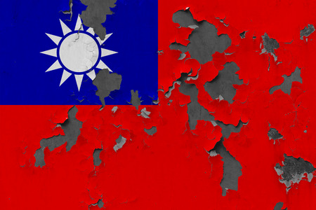 Close up grungy, damaged and weathered Taiwan flag on wall peeling off paint to see inside surface. Stockfoto