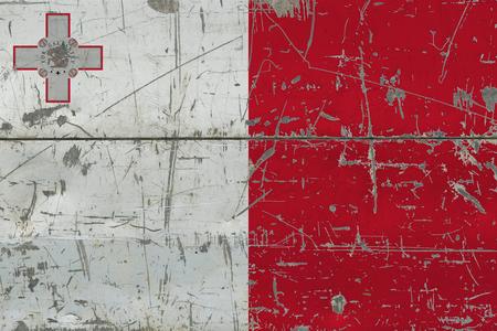 Grunge Malta flag on old scratched wooden surface. National vintage background. Banco de Imagens