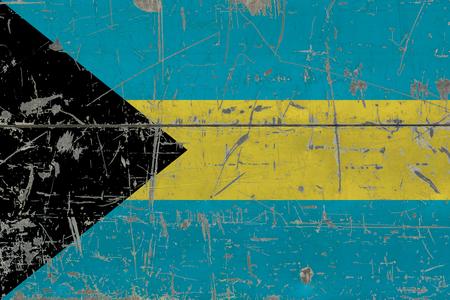 Grunge Bahamas flag on old scratched wooden surface. National vintage background. Banco de Imagens