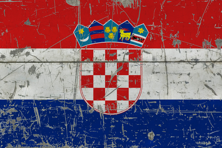 Grunge Croatia flag on old scratched wooden surface. National vintage background. 版權商用圖片