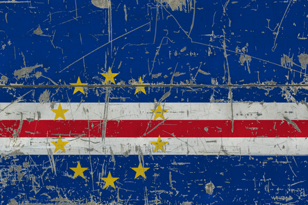Grunge Cape Verde flag on old scratched wooden surface. National vintage background. 版權商用圖片