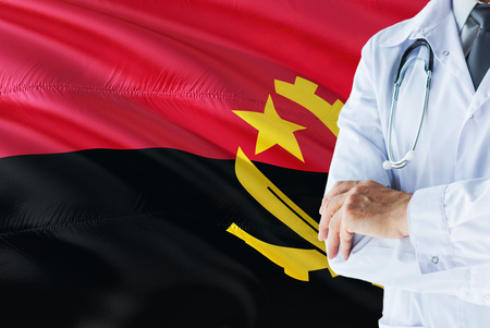Angolan Doctor standing with stethoscope on Angola flag background. National healthcare system concept, medical theme.
