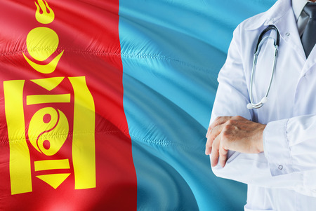 Mongolian Doctor standing with stethoscope on Mongolia flag background. National healthcare system concept, medical theme.