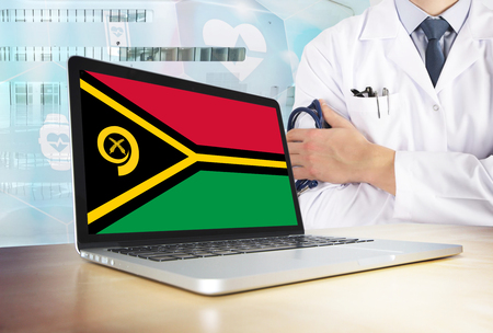 Vanuatu healthcare system in tech theme. Flag on computer screen. Doctor standing with stethoscope in hospital. Cryptocurrency and Blockchain concept.