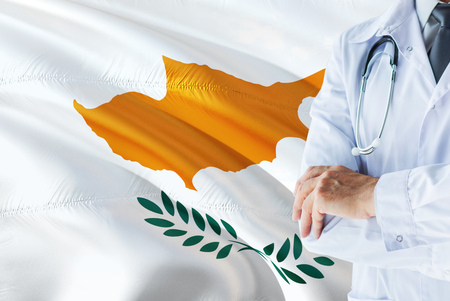 Cypriot Doctor standing with stethoscope on Cyprus flag background. National healthcare system concept, medical theme.