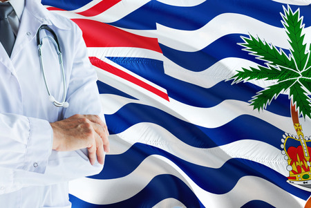 Doctor standing with stethoscope on British Indian Ocean Territory flag background. National healthcare system concept, medical theme.