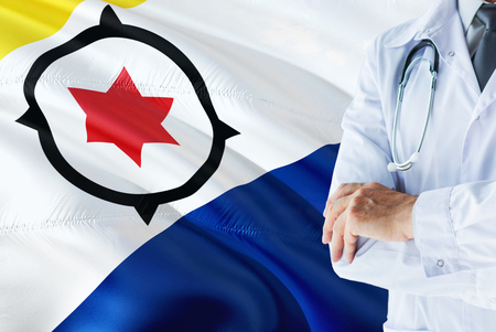 Doctor standing with stethoscope on Bonaire flag background. National healthcare system concept, medical theme.