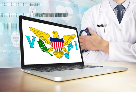 United states virgin islands healthcare system in tech theme. Flag on computer screen. Doctor standing with stethoscope in hospital. Cryptocurrency and Blockchain concept.
